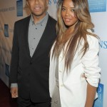 Russell Simmons (L) and Model/designer Angela Simmon